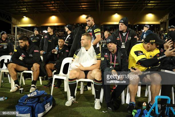 Trent Merrin of the Panthers sits on the sideline after injuring his hand during warm up in the round nine NRL match between the Penrith Panthers and...