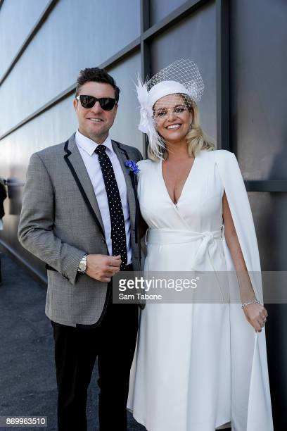 Trent Miller and Rebecca Maddern pose at Derby Day at Flemington Racecourse on November 4 2017 in Melbourne Australia