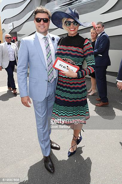Trent Miller and Rebecca Maddern pose in the Birdcage on Melbourne Cup Day at Flemington Racecourse on November 1 2016 in Melbourne Australia