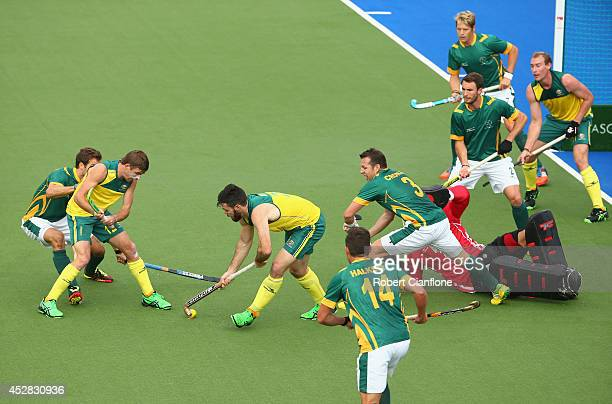 Trent Mitton of Australia shoots on goal to score during the Men's preliminaries match between South Africa and Australia at Glasgow National Hockey...