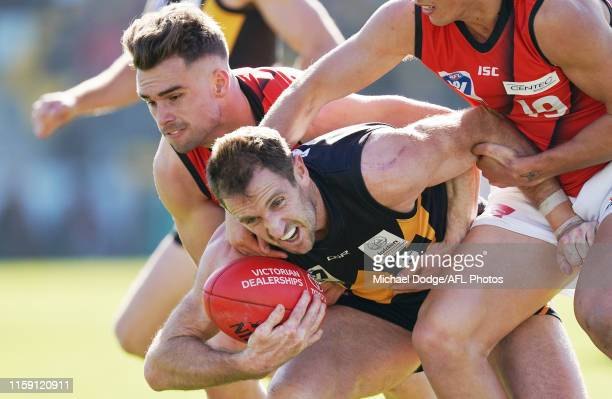 Trent Mynott of the Bombers tackles Michael Barlow of Werribee during the round 13 VFL match between Werribee and Essendon at Avalon Airport Oval on...