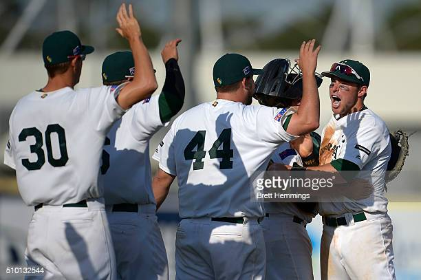 Trent Oeltjen of Australia celebrates victory with team mates during the World baseball Classic Final match between Australia and South Africa at...
