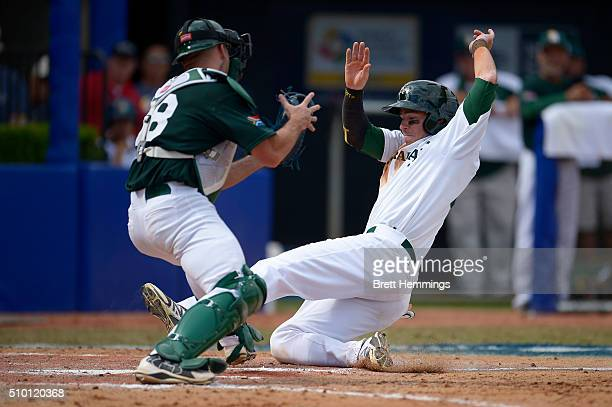 Trent Oeltjen of Australia slides into home base to score a run during the World baseball Classic Final match between Australia and South Africa at...