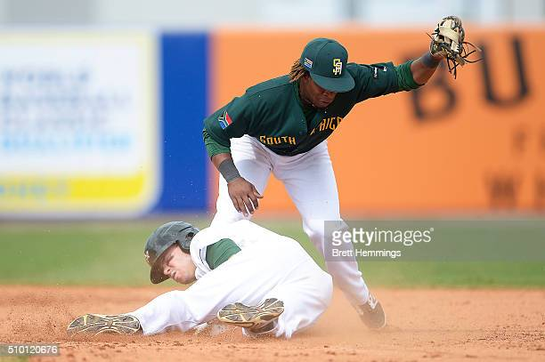 Trent Oeltjen of Australia slides into second base during the World baseball Classic Final match between Australia and South Africa at Blacktown...
