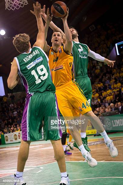 Trent Plaisted #44 of Limoges CSP competes with Mindaugas Kuzminskas #19 of Unicaja Malaga during the 20142015 Turkish Airlines Euroleague Basketball...