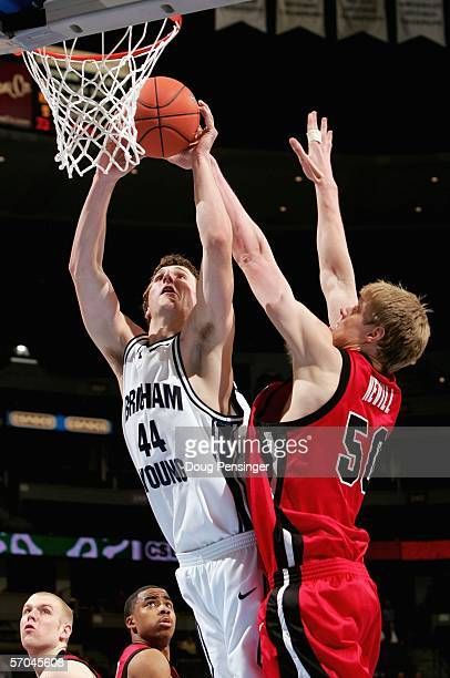 Trent Plaisted of the Brigham Young University Cougars tries to get off a shot against Luke Nevill of the Utah Runnin' Utes as the Utes upset the...