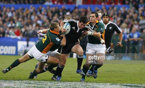 Trent Renata of New Zealand breaks a tackle from Stefan Watermeyer and Martin Muller of South Africa 21 April 2007, during the IRB Under 19 World...
