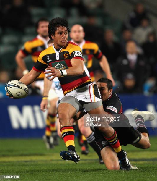 Trent Renata of Waikato is tackled by Chris Smylie of North Harbour during the round six ITM Cup match between North Harbour and Waikato at North...