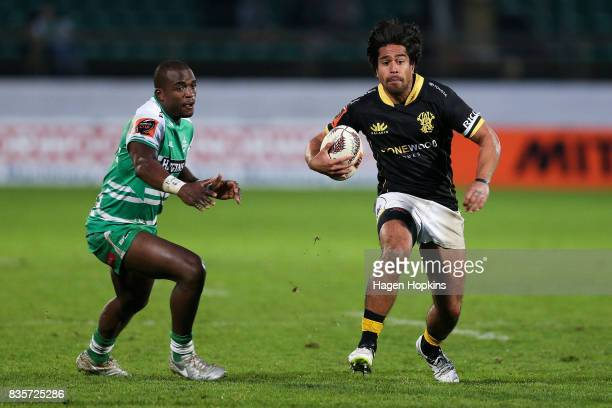 Trent Renata of Wellington beats the defence of Willy Ambaka of Manawatu during the round one Mitre 10 Cup match between Manawatu and Wellington at...