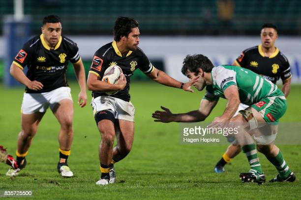 Trent Renata of Wellington fends Nick Crosswell of Manawatu during the round one Mitre 10 Cup match between Manawatu and Wellington at Central Energy...