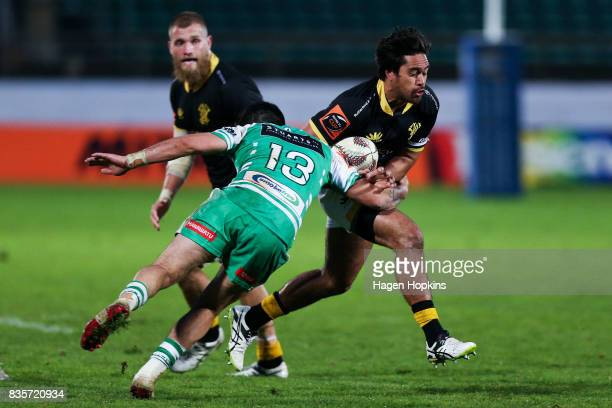 Trent Renata of Wellington is tackled by Lewis Marshall of Manawatu during the round one Mitre 10 Cup match between Manawatu and Wellington at...