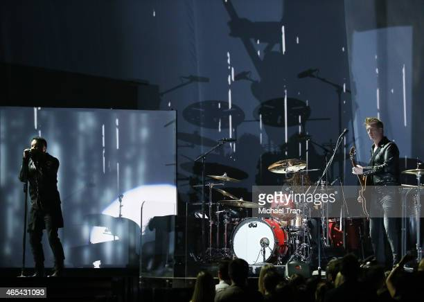 Trent Reznor and Joshua Homme perform onstage during the 56th GRAMMY Awards held at Staples Center on January 26 2014 in Los Angeles California
