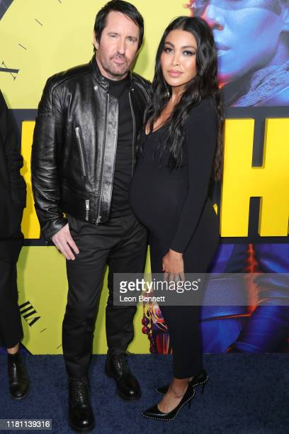 Trent Reznor and Mariqueen Maandig attend the Premiere Of HBO's Watchmen at The Cinerama Dome on October 14 2019 in Los Angeles California