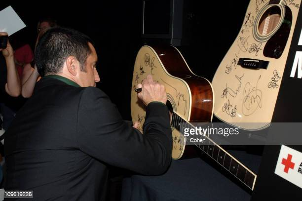 Trent Reznor signing items for auction in MTV VH1 CMT's ReAct Now Music Relief greenroom For more information about ReAct Now Music Relief please go...