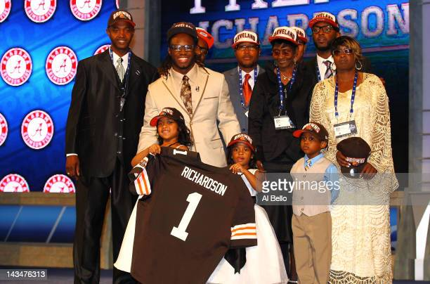 Trent Richardson from Alabama pose for a photo with family on stage after he was selected overall by the Cleveland Browns in the first round of the...