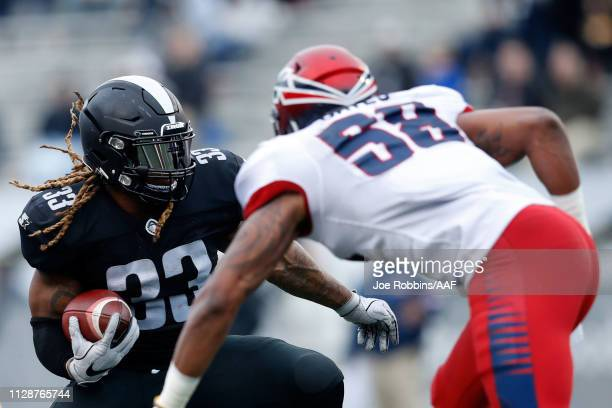 Trent Richardson of Birmingham Iron avoids a tackle by Corey Vereen of Memphis Express during an Alliance of American Football game at Legion Field...