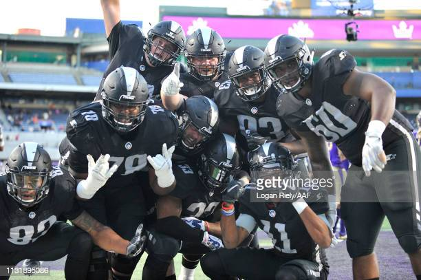 Trent Richardson of Birmingham Iron celebrates with his teammates after scoring a rushing touchdown against the Atlanta Legends during the third...