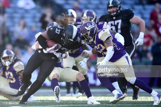 Trent Richardson of Birmingham Iron runs the ball against Khalil Bass of the Atlanta Legends during the first quarter of the Alliance of American...