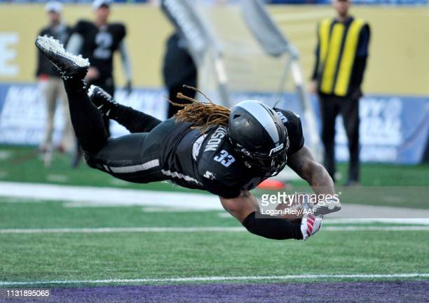 Trent Richardson of Birmingham Iron scores a touchdown against the Atlanta Legends during the third quarter of the Alliance of American Football game...