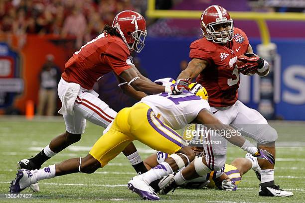 Trent Richardson of the Alabama Crimson Tide runs the ball against Morris Claiborne of the Louisiana State University Tigers during the 2012 Allstate...