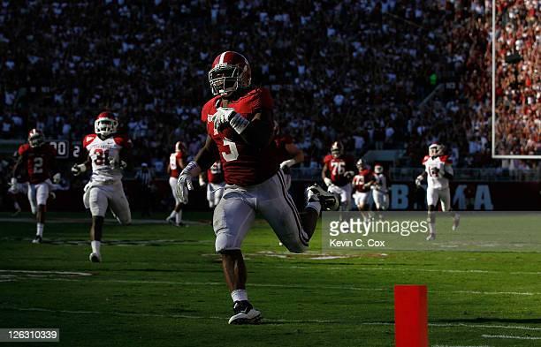 Trent Richardson of the Alabama Crimson Tide rushes for a touchdown against the Arkansas Razorbacks at BryantDenny Stadium on September 24 2011 in...