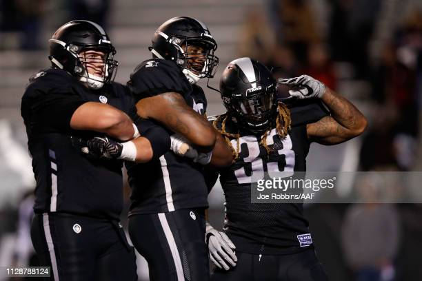 Trent Richardson of the Birmingham Iron celebrates a touchdown with teammates during an Alliance of American Football game against the Memphis...
