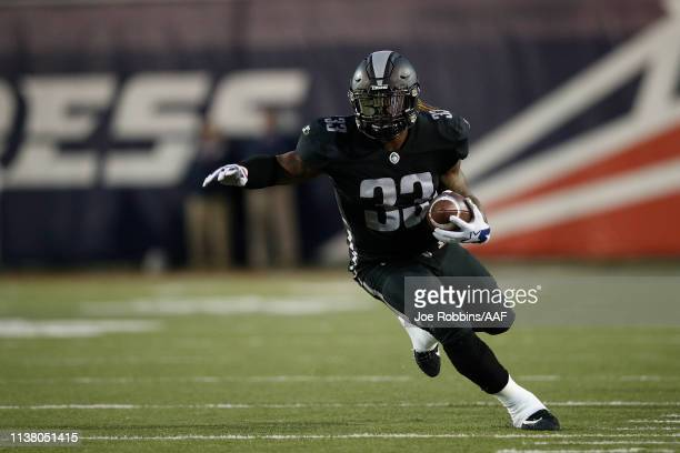 Trent Richardson of the Birmingham Iron runs the ball against the Memphis Express during the first quarter of their Alliance of American Football...