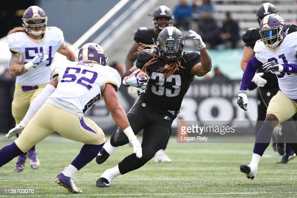 Trent Richardson of the Birmingham Iron runs the ball against the Atlanta Legends during the first half of the Alliance of American Football game at...