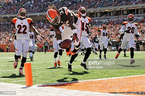 Trent Richardson of the Cleveland Browns flips into the endzone at the end of a 32yard touchdown run in the first half against the Cincinnati Bengals...