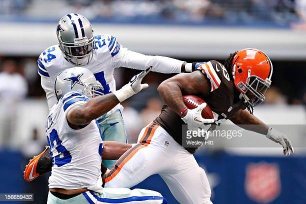 Trent Richardson of the Cleveland Browns is tackled during a game against the Dallas Cowboys at Cowboys Stadium on November 18 2012 in Arlington Texas