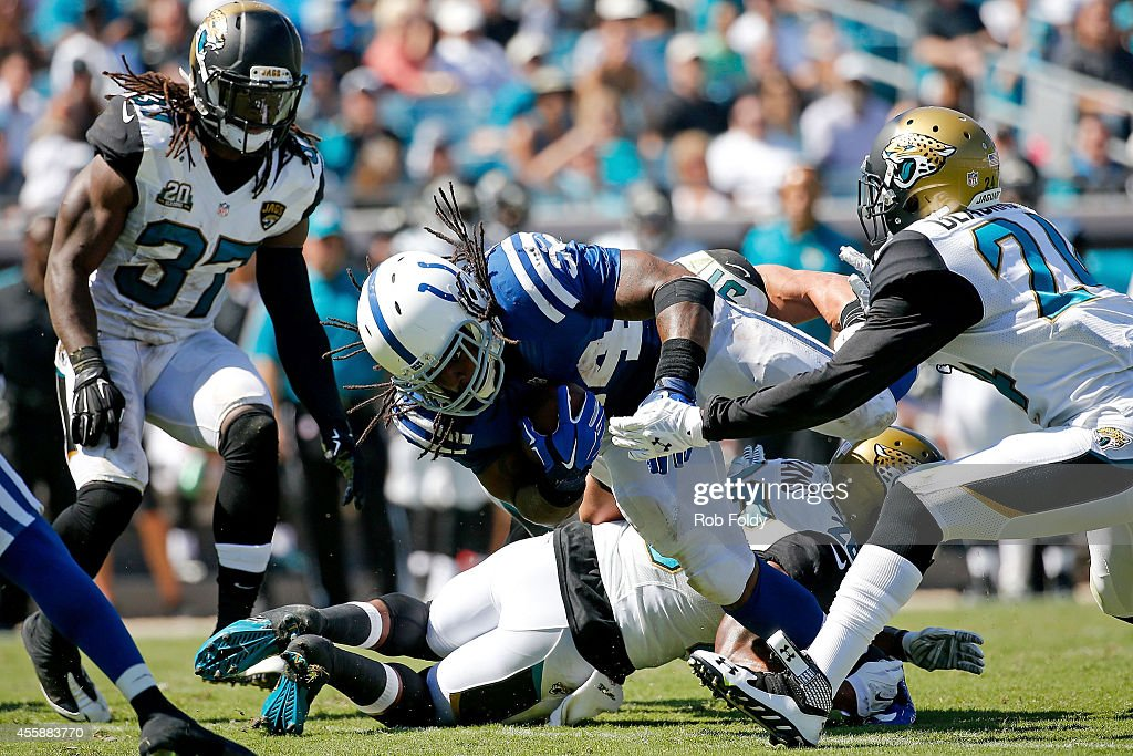 Trent Richardson #34 of the Indianapolis Colts carries during the second half of the game against the Jacksonville Jaguars at EverBank Field on September 21, 2014 in Jacksonville, Florida.