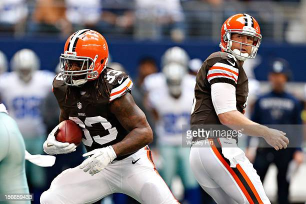 Trent Richardson takes a hand off from Brandon Weeden of the Cleveland Browns during a game against the Dallas Cowboys at Cowboys Stadium on November...