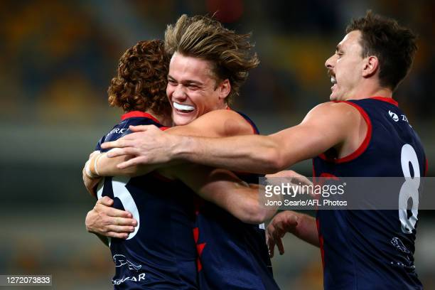 Trent Rivers of the Demons celebrates a Oskar Baker goal during the round 17 AFL match between the Greater Western Sydney Giants and the Melbourne...