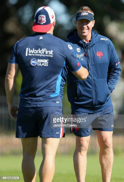 Trent Robinson head coach of the Roosters talks to Michael Gordon during a Sydney Roosters NRL training session at Kippax Lake on May 10 2017 in...