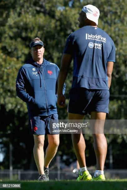 Trent Robinson head coach of the Roosters talks with Daniel Tupou during a Sydney Roosters NRL training session at Kippax Lake on May 10 2017 in...