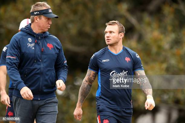 Trent Robinson speaks to Jake Friend as they arrive during a Sydney Roosters NRL training session at Allianz Stadium on July 31 2017 in Sydney...
