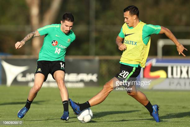 Trent Sainsbury and Jamie Maclaren compete for the ball during a Australian Socceroos training session at Lion FC Stadium on November 13 2018 in...