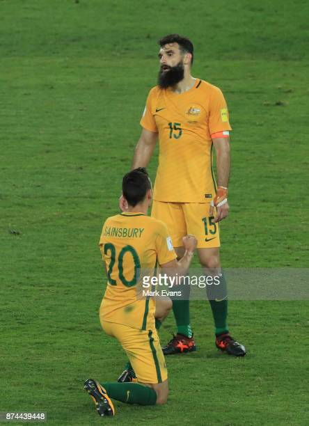 Trent Sainsbury and Mile Jedinak celebrate Australia's win after he 2018 FIFA World Cup Qualifiers Leg 2 match between the Australian Socceroos and...
