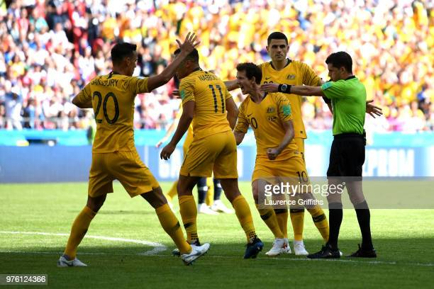 Trent Sainsbury Andrew Nabbout Robbie Kruse and Tom Rogic of Australia appeal to Referee Andres Cunha during the 2018 FIFA World Cup Russia group C...