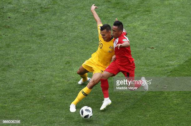 Trent Sainsbury of Australia and Christian Cueva of Peru battle for control of the ball during the 2018 FIFA World Cup Russia group C match between...