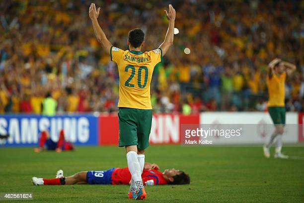 Trent Sainsbury of Australia celebrates victory as Kim Young Gwon of Korea Republic lies dejected on the ground during the 2015 Asian Cup final match...