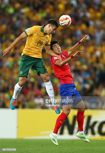 Trent Sainsbury of Australia competes for the ball against Lee Jeonghyeop of Korea Republic during the 2015 Asian Cup final match between Korea...