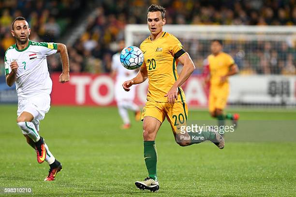 Trent Sainsbury of Australia runs onto the ball during the 2018 FIFA World Cup Qualifier match between the Australian Socceroos and Iraq at nib...
