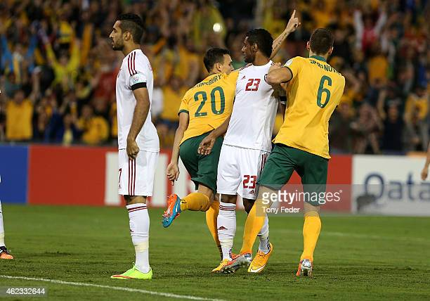 Trent Sainsbury of Australia scores a goal and celebrates during the Asian Cup Semi Final match between the Australian Socceroos and the United Arab...