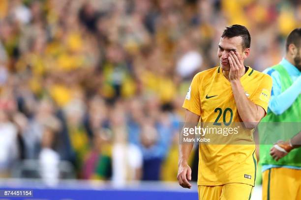 Trent Sainsbury of Australia wipes away tear as he celebrates victory during the 2018 FIFA World Cup Qualifiers Leg 2 match between the Australian...