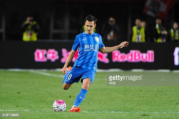 Trent Sainsbury of Jiangsu Suning kicks the ball during the round three match of CSL Chinese Football Association Super League between Hebei China...