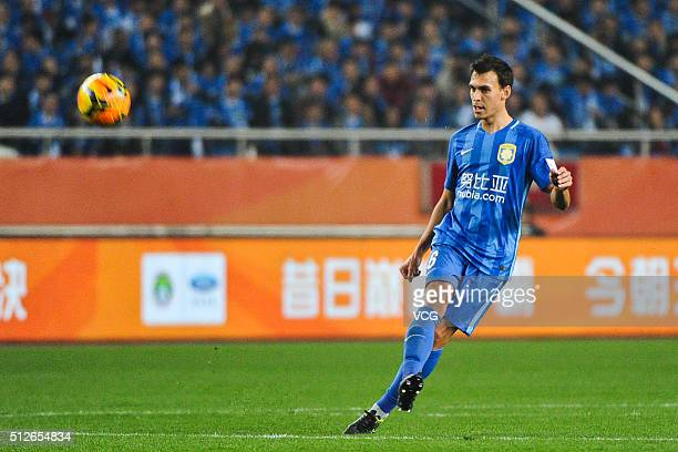 Trent Sainsbury of Jiangsu Suning runs with the ball during the 2016 CFA Super Cup between Guangzhou Evergrande FC and Jiangsu Suning FC at Chongqing...
