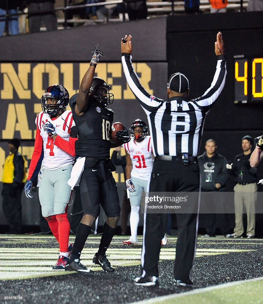 Trent Sherfield #10 of the Vanderbilt Commodores celebrates after scoring a touchdown against C.J. Hampton #4 of the Ole Miss Rebels during the first half at Vanderbilt Stadium on November 19, 2016 in Nashville, Tennessee.