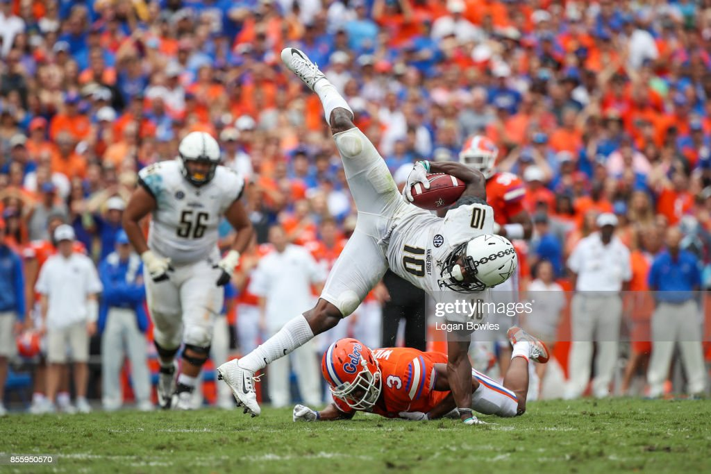 Trent Sherfield #10 of the Vanderbilt Commodores makes a catch as Marco Wilson #3 of the Florida Gators defends at Ben Hill Griffin Stadium on September 30, 2017 in Gainesville, Florida.