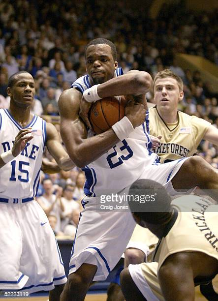 Trent Strickland of the Wake Forest Demon Deacons watches Shelden Williams of the Duke Blue Devils pull down a rebound on February 20 2005 at Cameron...
